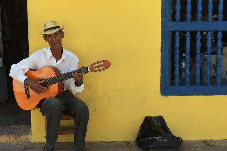 Man with guitar in Trinidad; Mercedes Santana